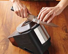 We use this electric whetstone knife sharpener from Shun to get the blades on our test kitchen knives up to snuff.  #food52 #saveur #summerfoodfights