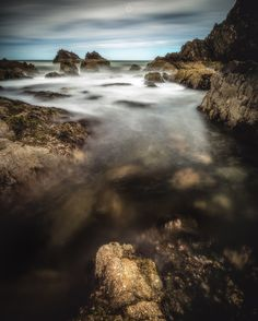 Channelling the Elements - A long exposure, landscape image of rocks on the coastline of Portknockie in Morayshire, Scotland.