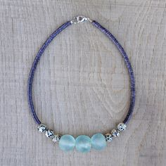 "Clio Necklace  This is a subtile colored necklace, mostly dark violet and light blue, inspired from ethnic jewellery with a modern touch.  The materials are vintage french sequins (vinyl disc beads), speckled dalmatian jasper beads, and 3 African glass recycled beads. It is 16,7"" long (42,5cm)."