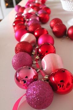 DIY Ornament Garland Tutorial from Jenny Dixon.use a garland of these to decorate tree.no single ornaments, a garland of many ornaments Noel Christmas, Pink Christmas, Christmas Projects, All Things Christmas, Winter Christmas, Holiday Crafts, Holiday Fun, Christmas Ornaments, Holiday Parties