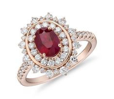 This impressive showstopper displays an oval-cut red ruby at the heart of this ring surrounded by a halo of diamond pave and prong-set petals of diamonds. Warm rose gold band brings its own sparkle with brilliant diamond pave along the sides of the band. Vintage Rose Gold, Wedding Rings Vintage, Rose Gold Engagement Ring, Diamond Wedding Rings, Engagement Ring Settings, Diamond Bands, Vintage Engagement Rings, Halo Diamond, Gold Bands