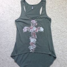 Top Olive green tank top. It is longer in the back. It has hardware studs around the front neckline and red, pink & whites roses that make cross. Full Tilt Tops Tank Tops