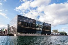 The Black Diamond is a modern waterfront extension to the Royal Danish Library's old building on Slotsholmen in central Copenhagen, Denmark. Its quasi-official nickname is a reference to its polished black granite cladding and irregular angles.