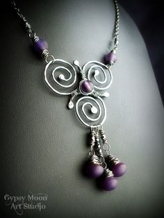 Celtic Triskele.  Sterling Silver and Purple Glass Necklace.