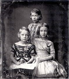Three elegant sisters that somehow seem so much more mature than their years. Life was a very different world in those days. (1845 Daguerreotype.)