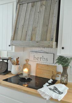 Pallet vent a hood in kitchen.  I'm loving this...  #Pallets #palletdesign #palletdecor #rustic #allthingspallets #repurposed