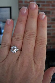 3.11 carat solitaire.. Holy crap that is beautiful