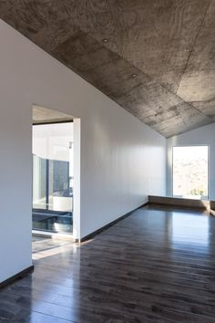 New Single Family House by T38 Studio - Medina used low-cost materials throughout the project. Inside, the exposed concrete ceilings are patterned with the imprint of the plywood formwork.