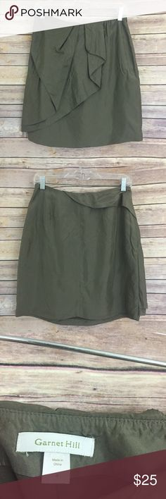 "Garnet Hill size 4, olive green silk skirt (#187) This olive green on trend spring mini skirt is 100% silk and has a faux wrap detail on the front of the skirt.  It is a size 4 measuring 14"" flat across the waist and is 18.5"" long. garnet hill Skirts Mini"