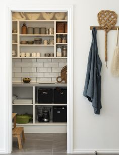 This eclectic home mixes mid-century and industrial style with vintage finds Pantry Interior, Interior Styling, Ikea Bunk Bed, String Shelf, Laundry Nook, Cupboard Storage, Kitchen Storage, Brown Sofa, Outdoor Living Areas