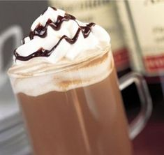 Amaretto Mochaccino: This cup of joe is truly worth a coffee break. Almond-flavored syrup (or amaretto), whipped cream and a drizzle of chocolate syrup makes this drink better than anything you can get from your local barista. Sweet Recipes, New Recipes, Favorite Recipes, Drink Recipes, Delicious Desserts, Yummy Food, Chocolate Syrup, Hot Chocolate, Smoothie Drinks