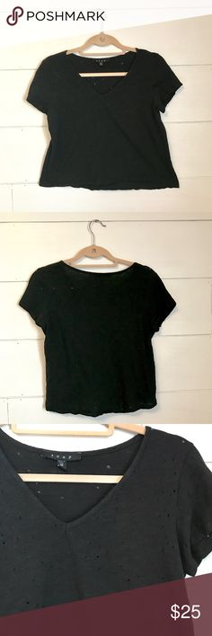 NWOT Distressed Holey Black Crop Top Snap brand distressed holey crop top in black! New without tags! Didn't realize it was a cropped shirt when I bought it and my belly just barely sticks out the bottom so that's the only reason I'm selling it! Size medium Snap Tops Crop Tops