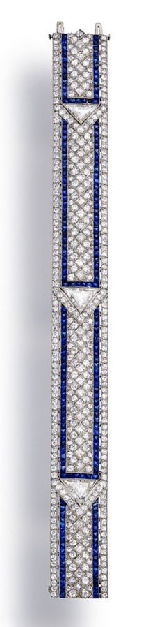 An art deco diamond and sapphire bracelet, Oscar Heyman & Brothers, circa 1923 of geometric design, set throughout with transitional and square step cut-diamonds, with French-cut sapphire detail; centering three triangular-cut diamonds, weighing 2.87 carats total; with maker's mark for Oscar Heyman & Brothers; no. 10517; estimated remaining total diamond weight: 24.60 carats; mounted in platinum; length: 7 1/8in.