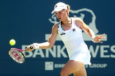 Marina Erakovic of New Zealand returns a sho to Jana Juricova of Slovakia during the Bank of the West Classic at Stanford University Taube Family Tennis Stadium on July 10, 2012 in Stanford, California.