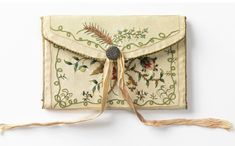 Pocket book, covered in embroidered satin, 19th century. Cooper Hewitt Museum.
