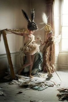 TIM WALKER - STORY TELLER - Stella Tennant in hare mask and Charles Guislain in birds of paradise crown, Howick Hall, 2010