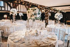 Tall globe wedding centrepieces. Dusky pink and ivory flowers. Menta roses, sweet avalanche roses, orchids. Great Fosters wedding. Surrey wedding flowers by Boutique Blooms floral design.