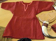 Viking tunic showing gores. The complexity results in a garment that doesn't bind or restrict movement. The upper part of the garment is relatively tight-fitting, but the sleeves are fitted to provide freedom of motion. The skirt ranged from thigh length to knee length. As with most articles of clothing, the length was determined by the wealth of the owner.  On hot days, the skirt was lifted up and tucked into the belt. Sleeves were probably reaching well past the wrists.