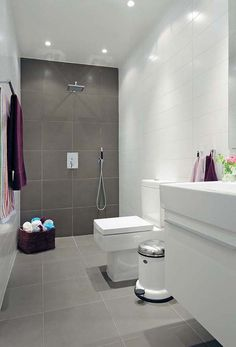 I love this look. Grey & white tiles. Makes the bathroom look big