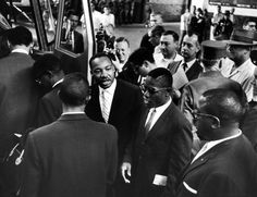 Martin Luther King Jr. was born on this day in 1929. He's pictured here in 1961 with the Freedom Riders, who rode interstate buses to protest the unconstitutional segregation of public buses, often putting their lives at great risk. See more: http://ti.me/1ydgMQ0  (Paul Schutzer—The LIFE Picture Collection/Getty Images)