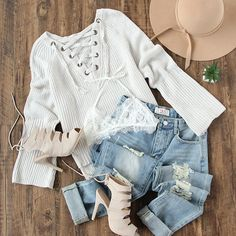 Pair your lace up knit pullover with ripped denim jeans for a cozy & stylish vibe. #outfits #sweaterweather #fashion
