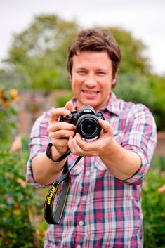 Jamie Oliver...I love him for his passion not just for cooking but for working his ass off to educate the world and physically drive change. Absolutely amazing