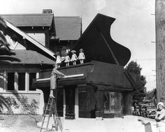"""The California Piano Supply Co.(aka. Doc Manning's Big Red Piano), circa 1930. Once located at 2251 Venice Blvd. near Western, it's now the site of """"Charlie's Fixtures, Inc.""""  The building was an architectural icon for over 40 years. The New Yorker Magazine once described it as """"evidence of Southern California's special brand of madness."""" (Bizarre Los Angeles)"""