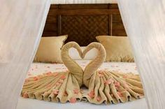 Just in time for Valentine's Day. Learn how to make these towel origami heart shaped swans online at http://FoldingMagic.com .