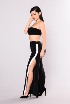 - Available In Black - Mid Rise - Wide Leg - High Side Slits - White Side Stripe Detail 92% Polyester 8% Spandex