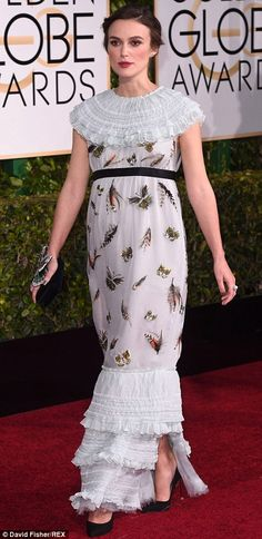 Baby on board: Keira hid her tiny baby bump under a shapeless Chanel dress, which was embe...