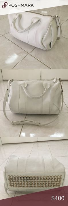 Alexander Wang Rocco Duffle Bag White leather, slight wear, but definitely durable and will last a lifetime! I love this bag selling only because money is tight. Alexander Wang Bags Crossbody Bags