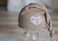 Upcycled newborn hat beanie top knot photography prop brown tan white lace heart. $20.00, via Etsy.
