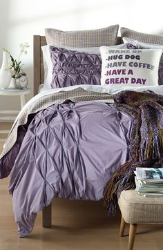 The ruching on this lavender bedding looks so comfy.