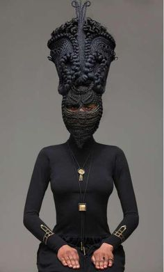 Photographer Delphine Diaw Diallo's new series of photographs entitled HIGHNESS & these photos of women wearing elaborate woven masks are truly something to see. The series features models wearing extremely thought-out head pieces. These masks are created out of what looks to be a large amount of braided hair.