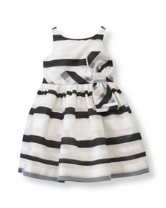 Janie & Jack Organdy Striped Dress Crafted in sweet and airy organdy, our special celebration design features charming contrast stripes with a subtle sheen. A pieced belt with a tiered bow and pearlized back buttons add timeless detail. The fancy silhouette is finished with a tulle-enhanced underlayer for extra flounce.