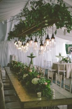 Absolutely beautiful lanterns hanging over a rustic long wooden tressel style table. Photography: Erin Jean Photography - www.erinjeanphoto.com Read More: http://www.stylemepretty.com/2014/12/03/rustic-wisconsin-backyard-wedding/