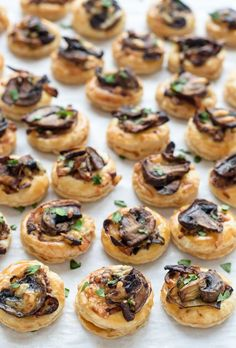 An easy and delicious mushroom puff pastry appetizer: store bought puff pastry rounds topped with caramelized onions, garlic sautéed mushrooms, and cheese.