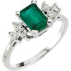 Emerald & Diamond Ring | Aston Royal  This Emerald and Diamond Ring is set with:  1 x 7mm x 5mm Emerald-Cut, Genuine Emerald   6 x 2mm, Full Cut, I1 Clarity, G - H Color, Round Diamonds  The total diamond weight is 1/6 carat.