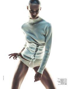 Birgit Kos wears Berenice cashmere and wool sweater, Prada corset and Petit Bateau underwear