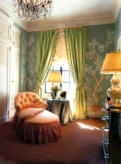 Light jade green Gracie paper, pistachio silk drapes, petite tufted back coral chaise, and tiny leopard upholstered lucite chair in the back right corner. This stunning space is one of Aerin Lauder's closets. Ya.   Thefoodogatemyhomework.tumblr.com