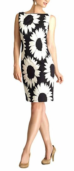 Black & Ecru Sunflower Sleeveless Dress I love the large sunflower print. Any color of cardigan will compliment this dress.