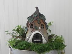 Welcome the fairies or gnomes into your garden with this whimsical cottage. The lovely vine pattern goes all around the top of the cottage. This will be a wonderful focal point in your garden and looks wonderful from all angles. The hinged door swings open so the fairies or gnomes can move right in! I have embellished the front door with a cloud white hand crafted wooden Welcome or Believe sign. The sign is first painted using an exterior paint and then it is engraved with the word Welcome…