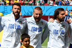 (L-R) Andrea Barzagli, Daniele De Rossi and Andrea Pirlo of Italy sing the National Anthem prior to the 2014 FIFA World Cup Brazil Group D m...