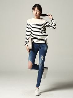 Striped black and white long sleeve top. I like the bare collar bone area.