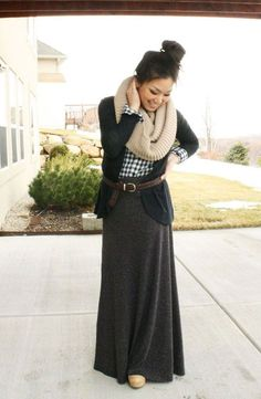 Tuck in a plaid shirt, wear a soft blazer over it for warmth, and then belt the whole look to cinch in your waist. | How to Wear A Maxi Skirt in the Winter