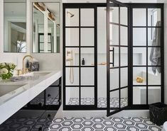 an etched glass window provides natural light in this master bathroom.