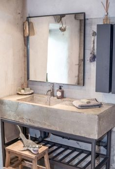 Concrete sink, cool soap dispenser, neat mirror, dried lavender, and THAT SHARK. This salle de bain has funky French written all over it. Industrial Bathroom Vanity, Bathroom Interior, Design Bathroom, Industrial Mirrors, Industrial Door, Industrial Shelving, Industrial Farmhouse, Industrial Wallpaper, Industrial Closet