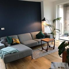 An inspirational image from Farrow and Ball Blue Feature Wall Living Room, Navy Living Rooms, Dark Blue Living Room, Living Room Paint, Home Living Room, Dark Blue Feature Wall, Living Room Color Schemes, Living Room Designs, Snug Room