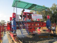 Concrete Paving Machine for Road and Airport Taxiway P{project, Model UNiSTEEL SRCP 720 Working on rail with Sensor