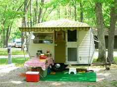 My mother always 'camped' just like this....with a larger trailer, a couple of runs and some comfortable chairs under the awning:-)